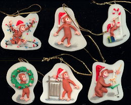 #CH419 - Boxed Set of 6 Porcelain Licensed Curious George Christmas Ornaments