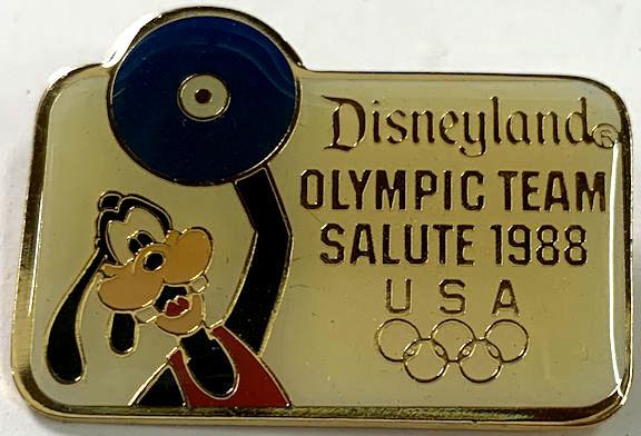 #CH487 - 1988 Disneyland Olympic Pinback - Goofy Weightlifting