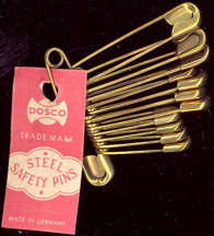 #CS249 - Group of 12 Pre WWII German Brass Plated Safety Pins with Tag