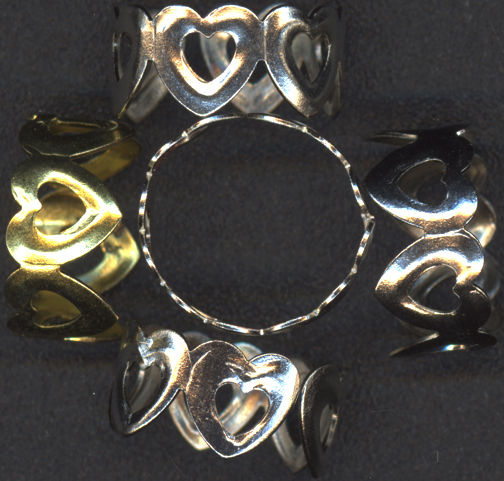 #TY447 - Group of 10 Tin Linked Hearts Adjustable Size Dimestore Rings