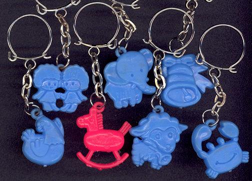 #TY397 - One Dozen Assorted 1960s Charm Keychains