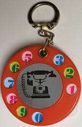 #TY771 - Group of 4 Keychains with Old Telephone Pictured - Tabs Flip out to Write Your Phone Numbers