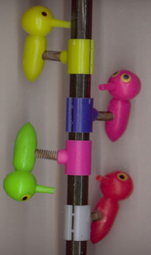 #TY549 - Group of 12-  Pecking Woodpeckers on a Spring Pencil Hanger Toys