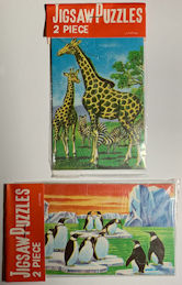 #TY846 - Group of 3 Made in Japan Puzzle Packages with Two Puzzles in Each - Giraffe and Penguin Puzzles